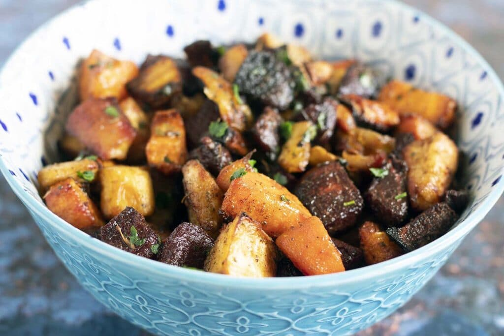 oven roasted vegetables in blue and white bowl