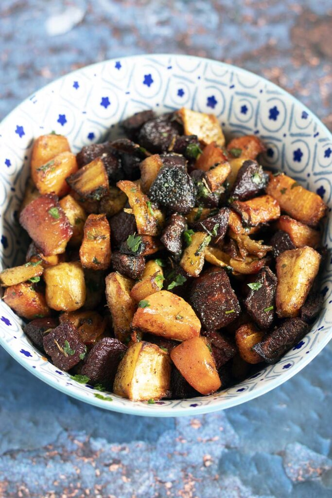 colourful oven roasted vegetables in blue and white bowl