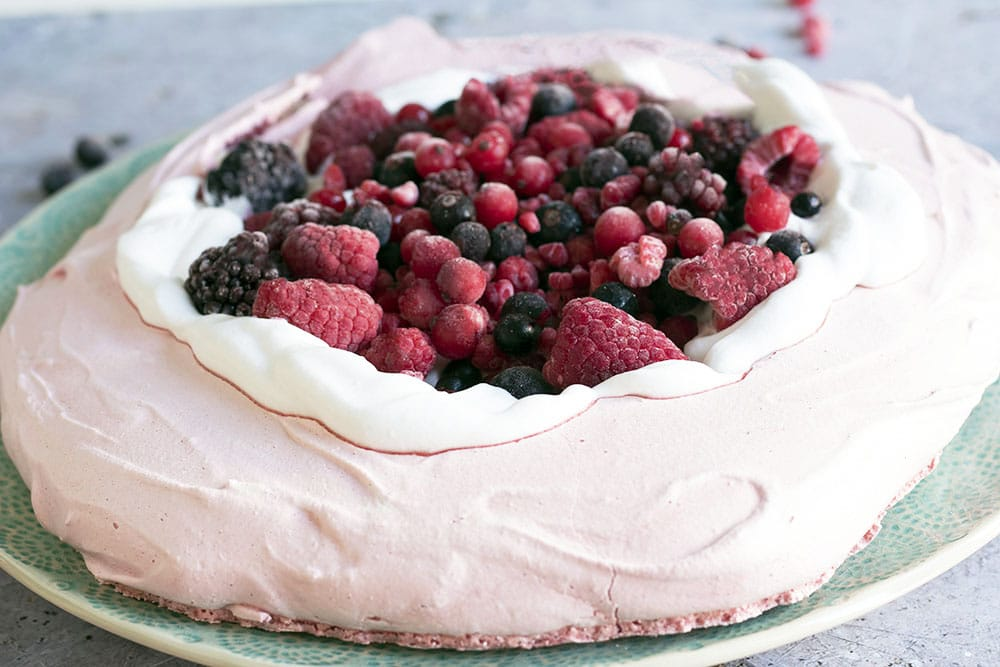 vegan aquafaba pavlova with coconut cream and berries