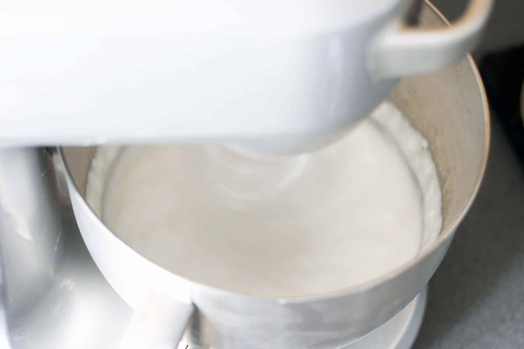 meringue being mixed in stand mixer