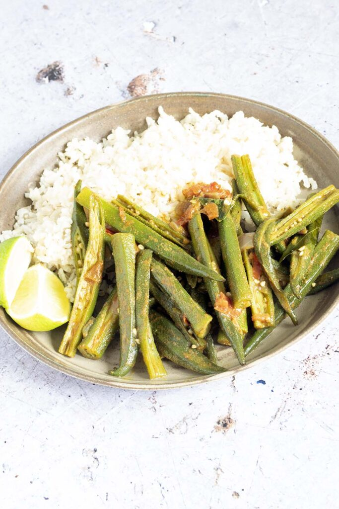 okra curry and rice on ceramic plate