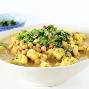 vegan korma recipe with parsnips, chickpea and cauliflower in bowl