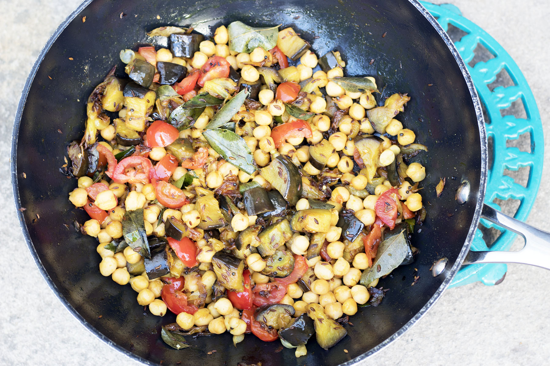 aubergine and chickpea curry in wok