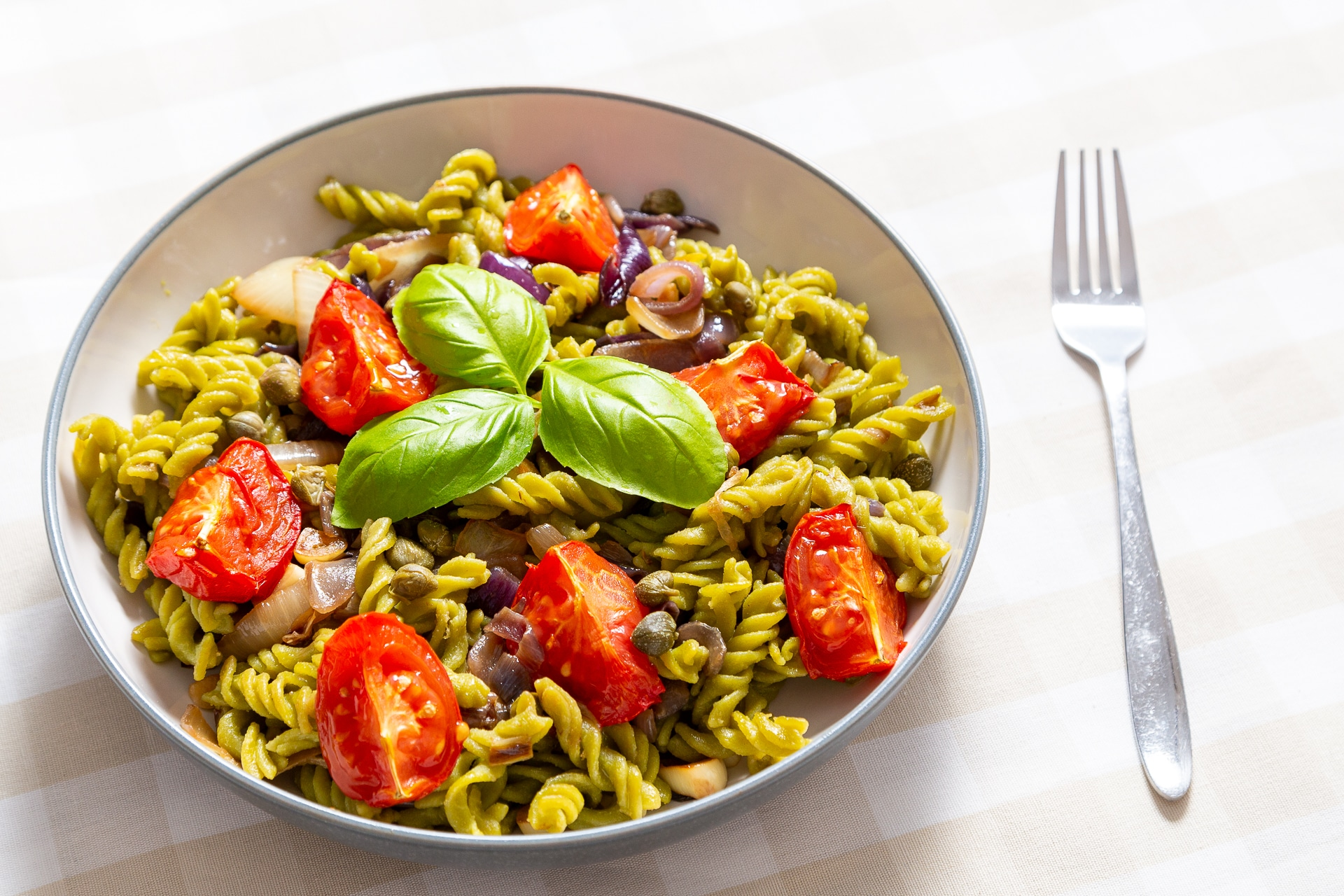 easy vegan pasta recipes - vegan pea pasta with slow roasted tomatoes and caramelised onions by Honest Mum