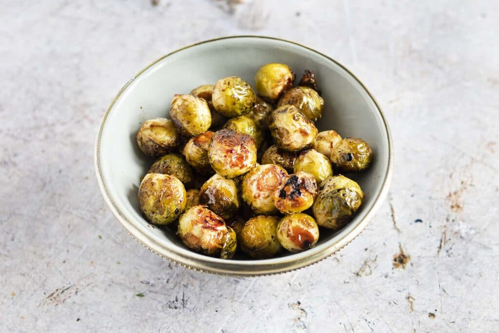 balsamic roasted brussels sprouts in grey bowl