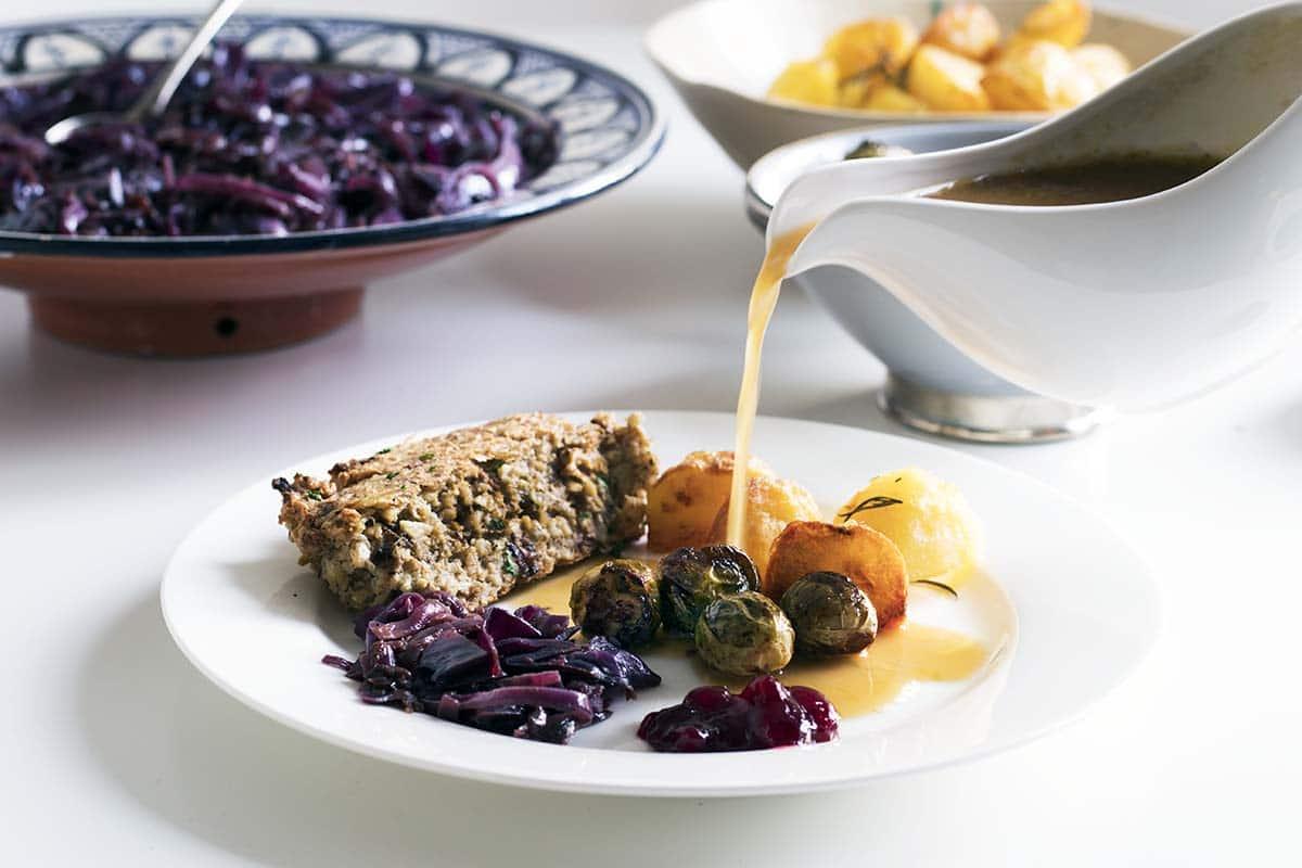 Vegan Christmas roast dinner including the best vegan gravy. Recipe by Cook Veggielicious