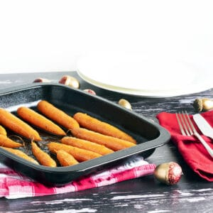 roasted carrots with maple syrup in roasting tin