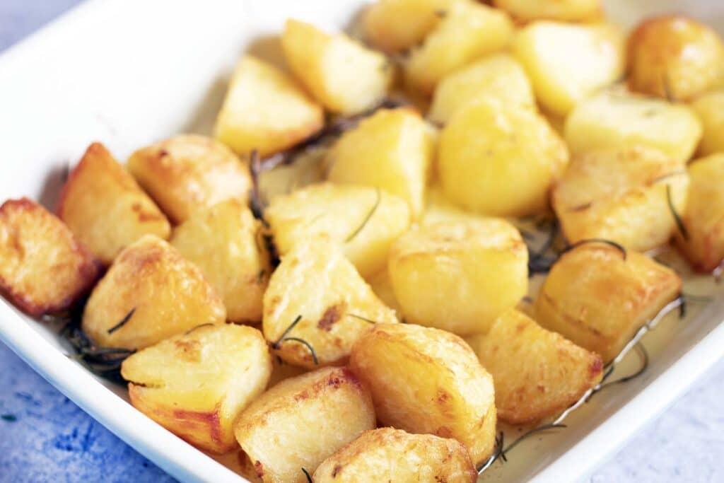 rosemary roast potatoes in roasting dish
