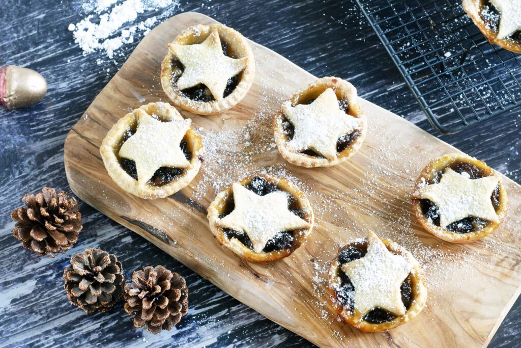 vegan mince pies with star tops on wooden board