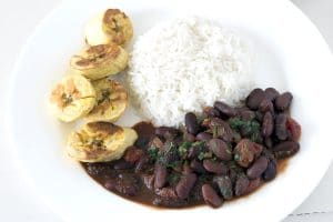 Vegan African bean stew with rice and baked plantains