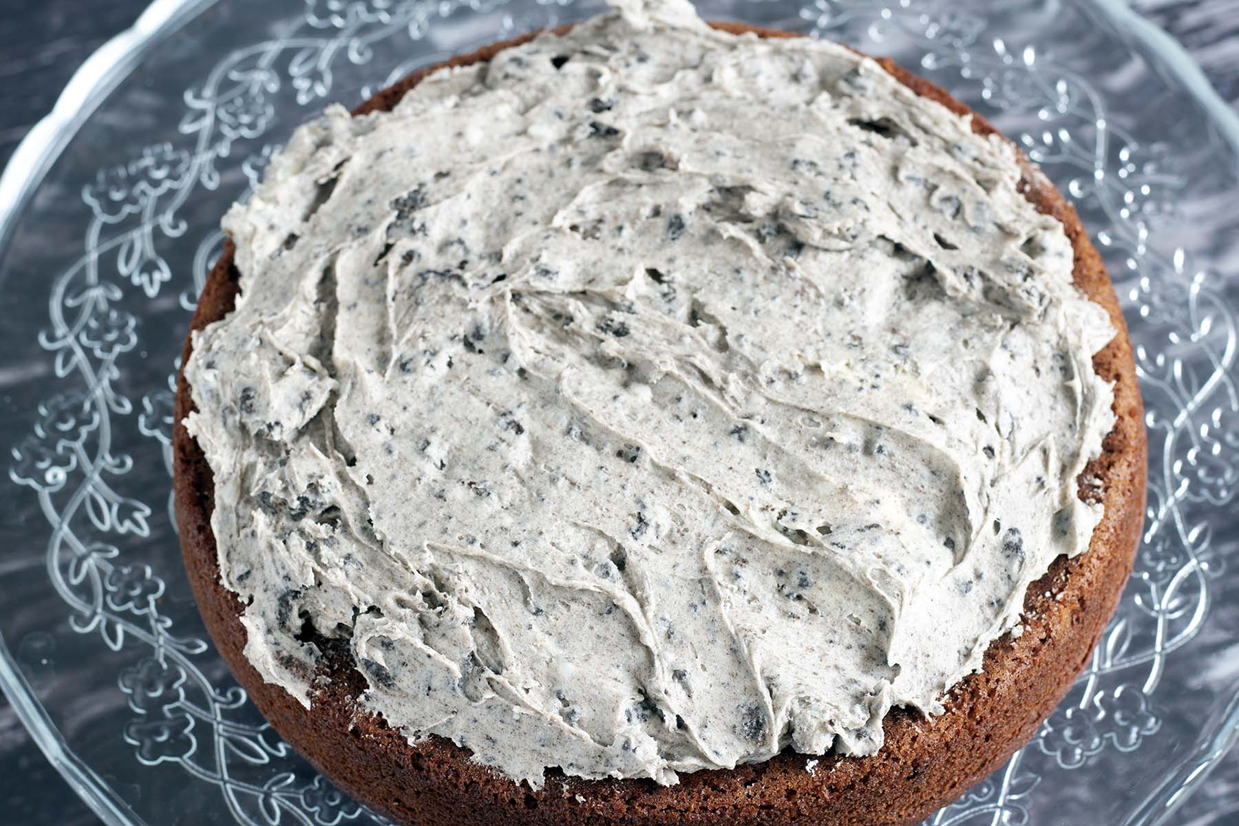vegan sandwich cake with frosting on bottom tier