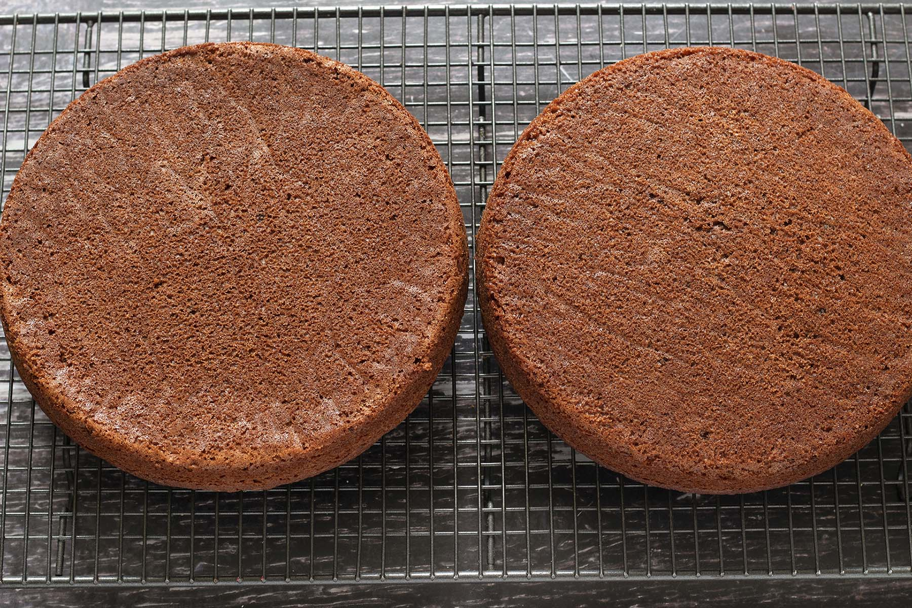 two vegan sandwich cakes on cooling rack