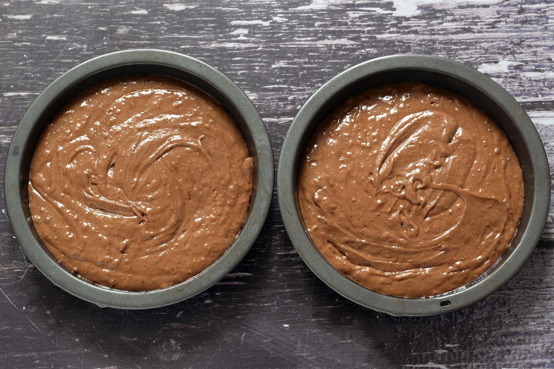 unbaked vegan chocolate cakes in tin