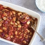 Baked Greek beans with tomato sauce in roasting tine
