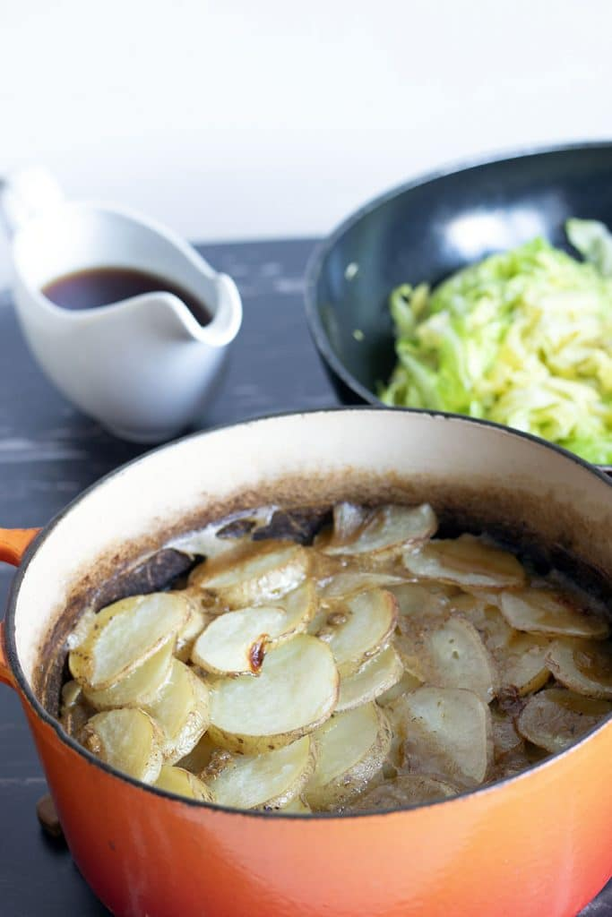 vegan hot pot with cabbage and gravy in background