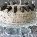 vegan oreo cake on cake stand. recipe by Cook Veggielicious