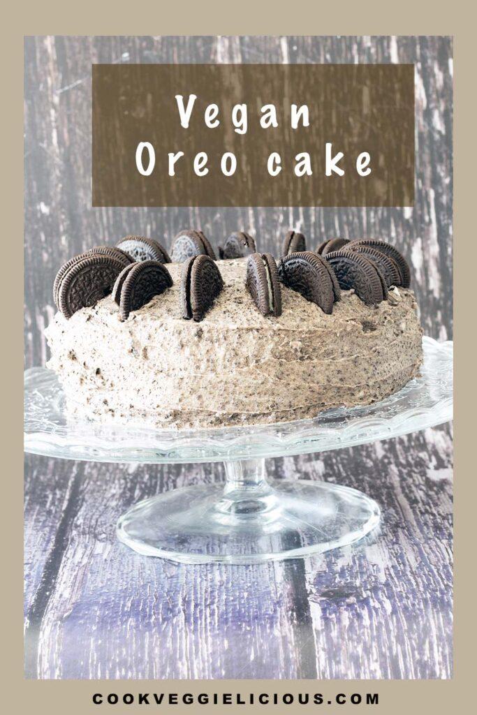 vegan oreo cake on glass cake stand