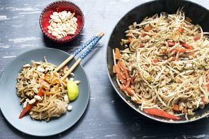 vegan pad thai in wok and on plate with chopsticks - recipe by Cook Veggielicious