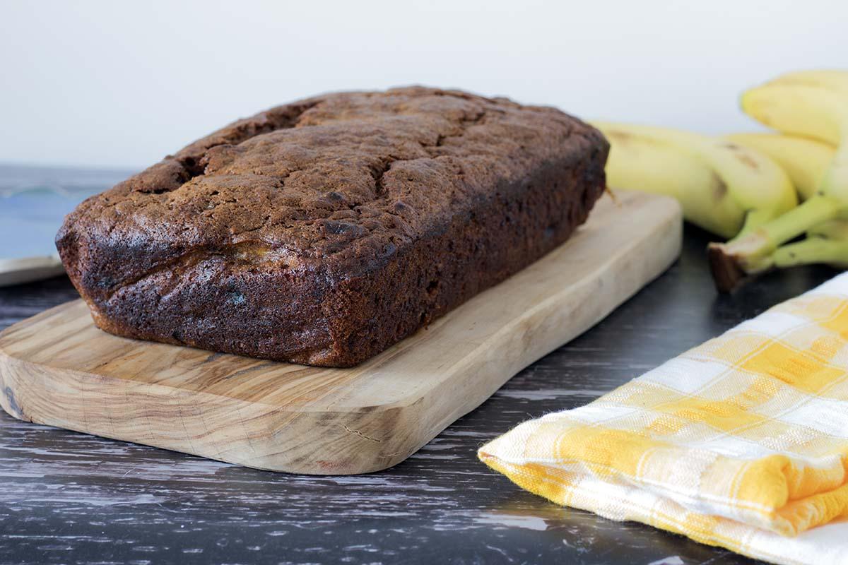 uncut spiced vegan banana bread on wooden board