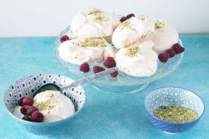 vegan aquafaba meringue with rosewater, pistachio and raspberries