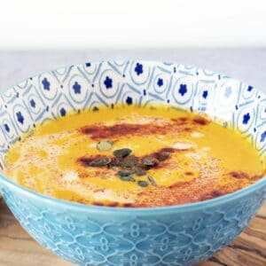 spiced carrot soup in blue and white bowl