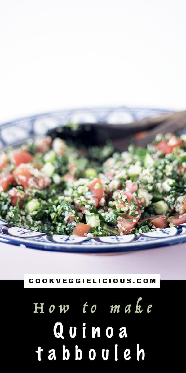 vegan quinoa tabbouleh in blue bowl with wooden spoon