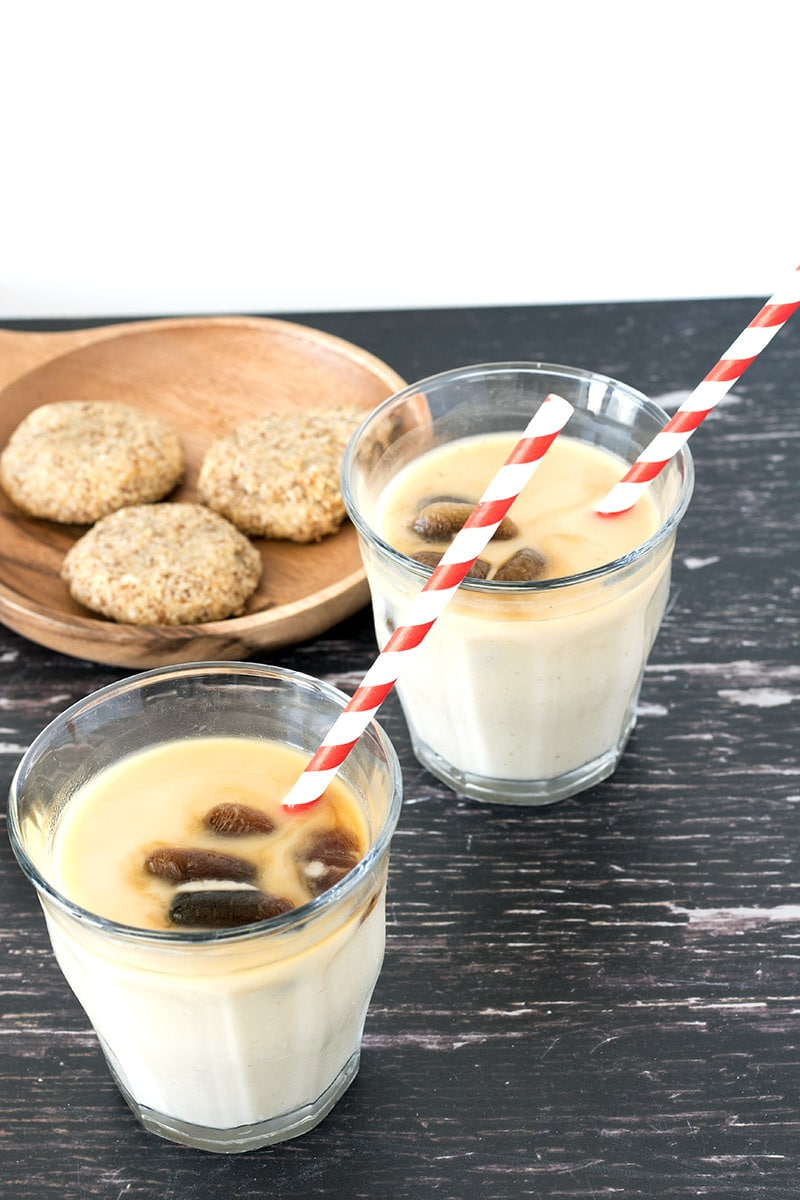 vegan iced coffee in glasses with cookies in background