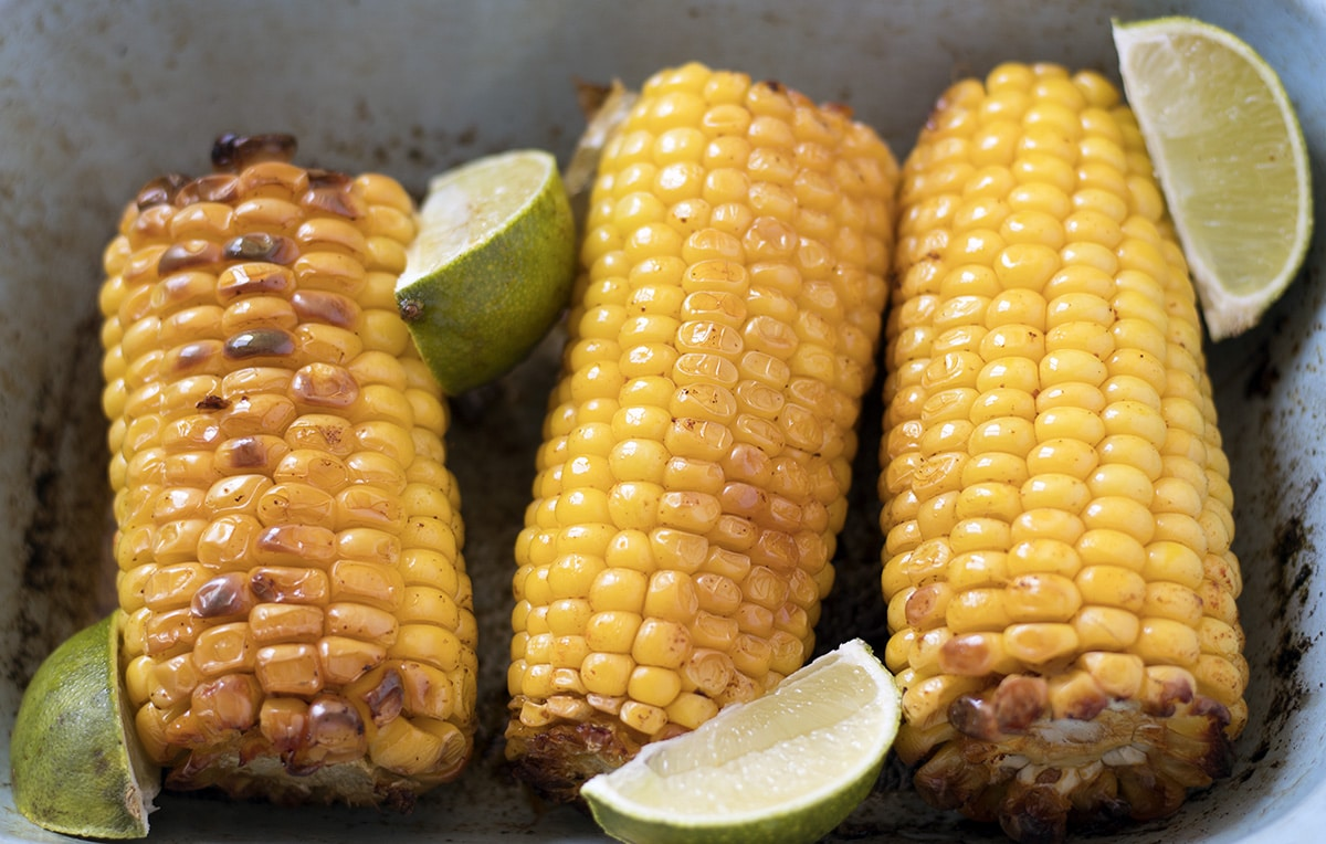 roast corn in blue dish with lime