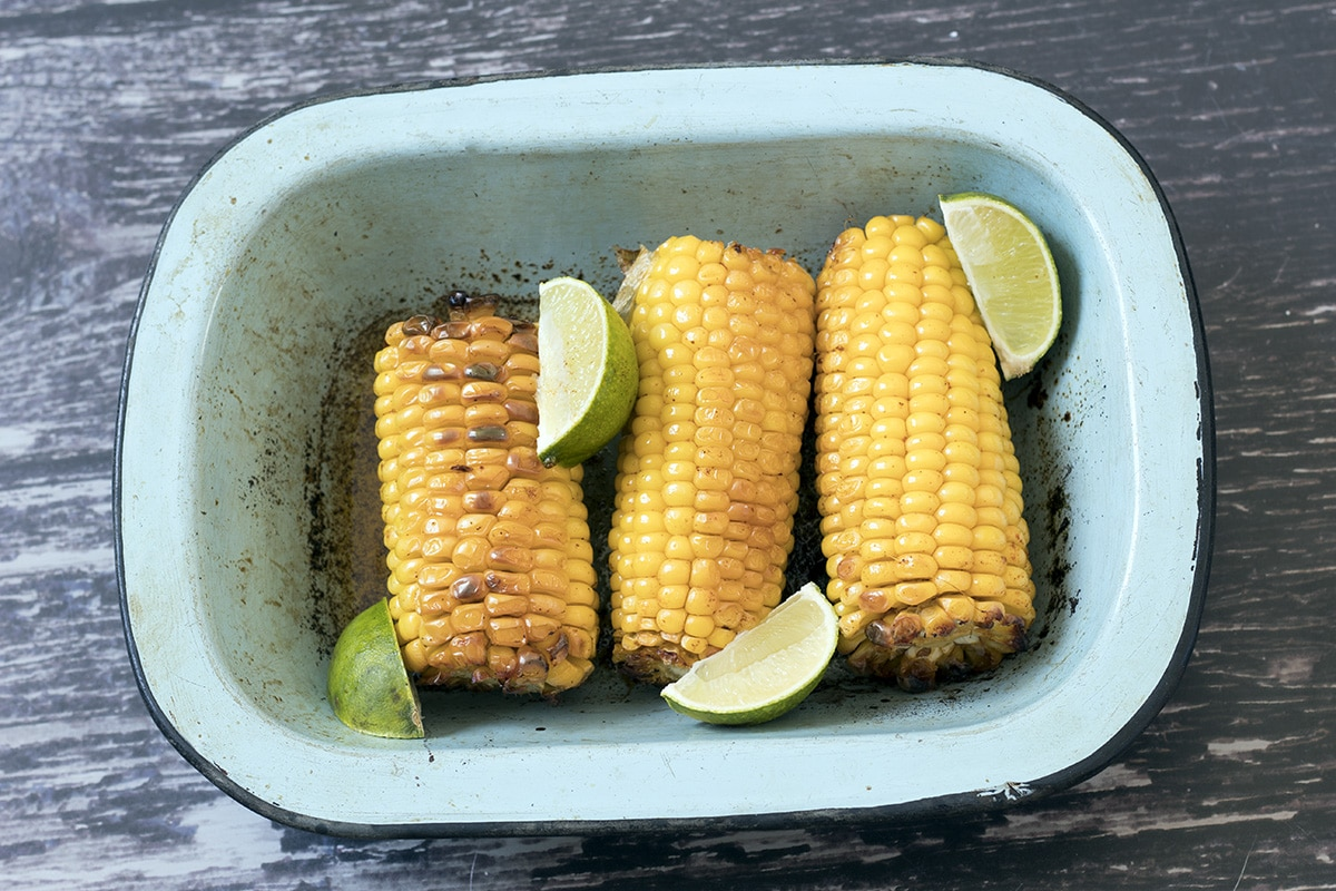 roasted corn on the cobs in blue dish
