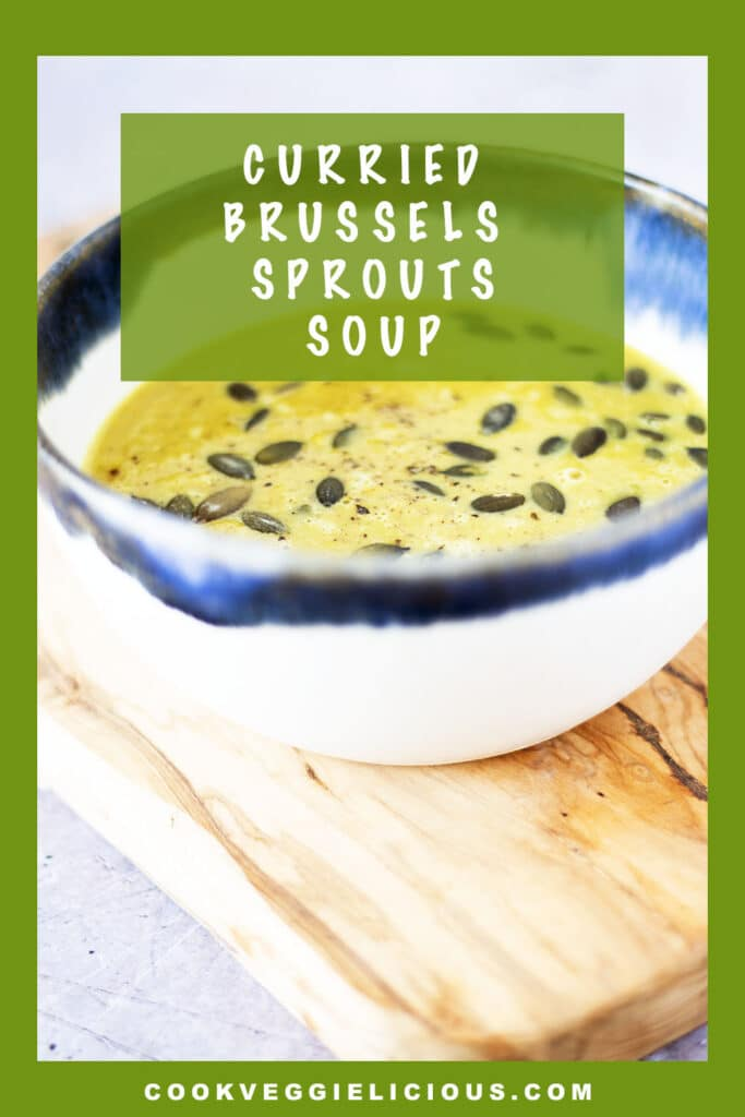 curried brussels sprouts soup in blue and white bowl
