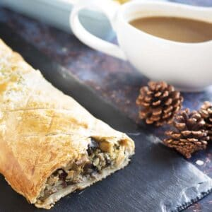 Christmas parsnip and mushroom wellington with gravy in background