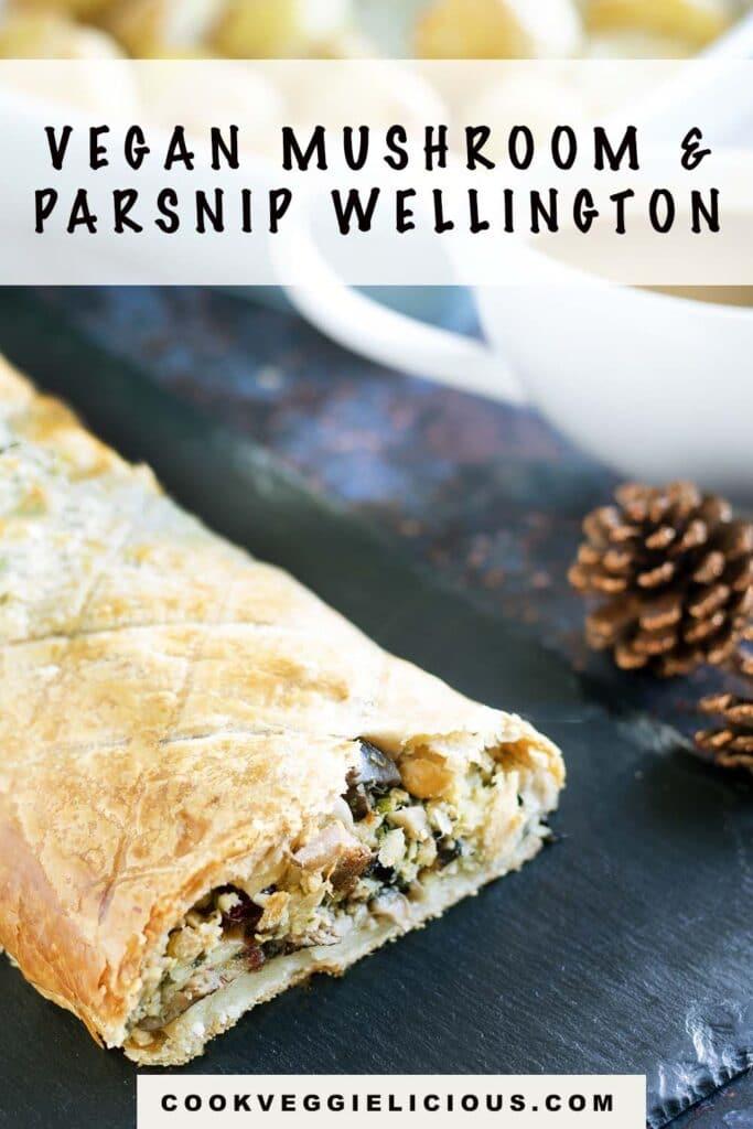 close up of vegan christmas wellington with pine cones, gravy and roast potatoes