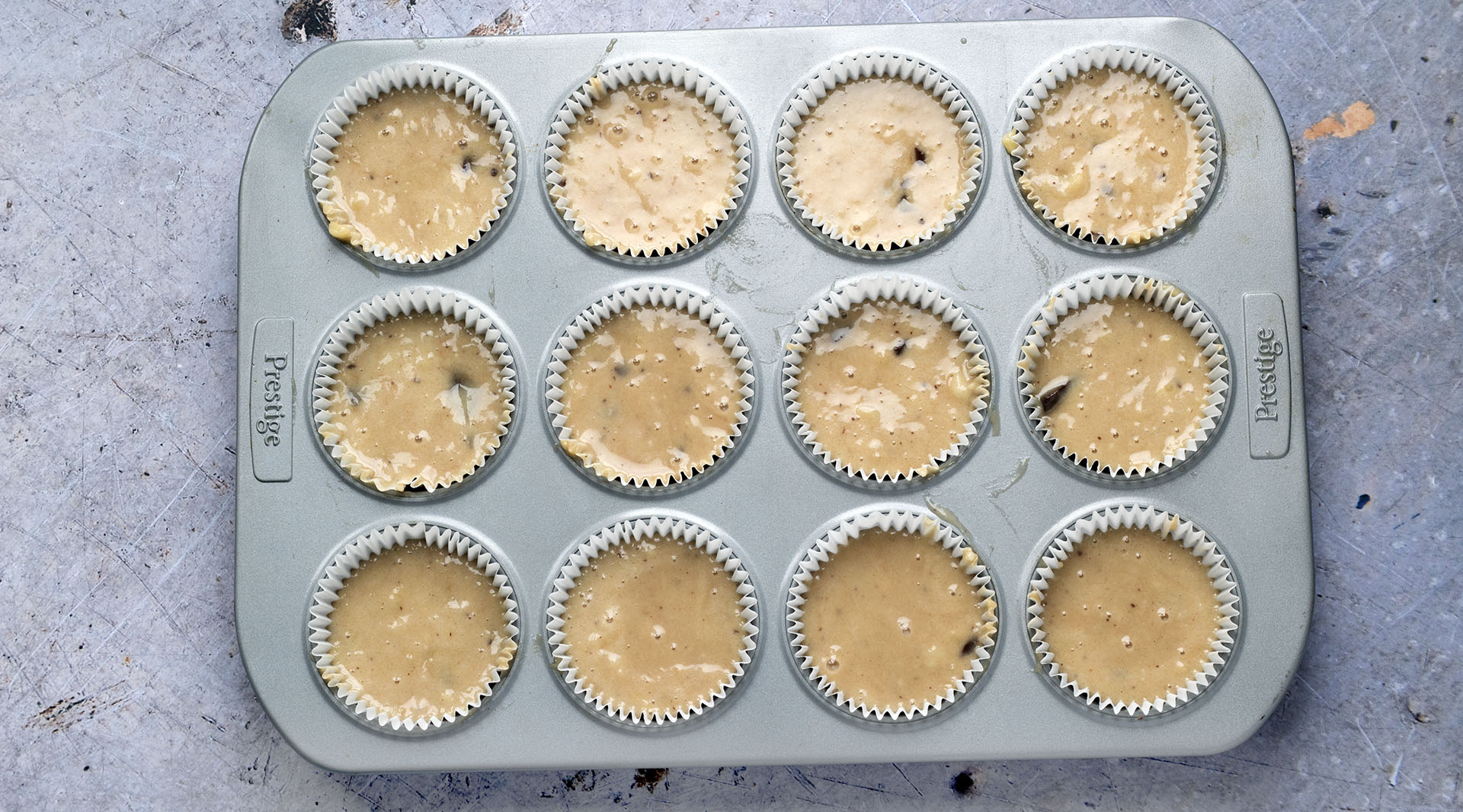 uncooked banana muffins in muffin cases