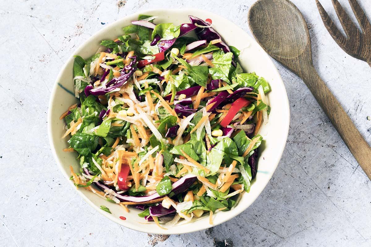 rainbow salad in cream bowl
