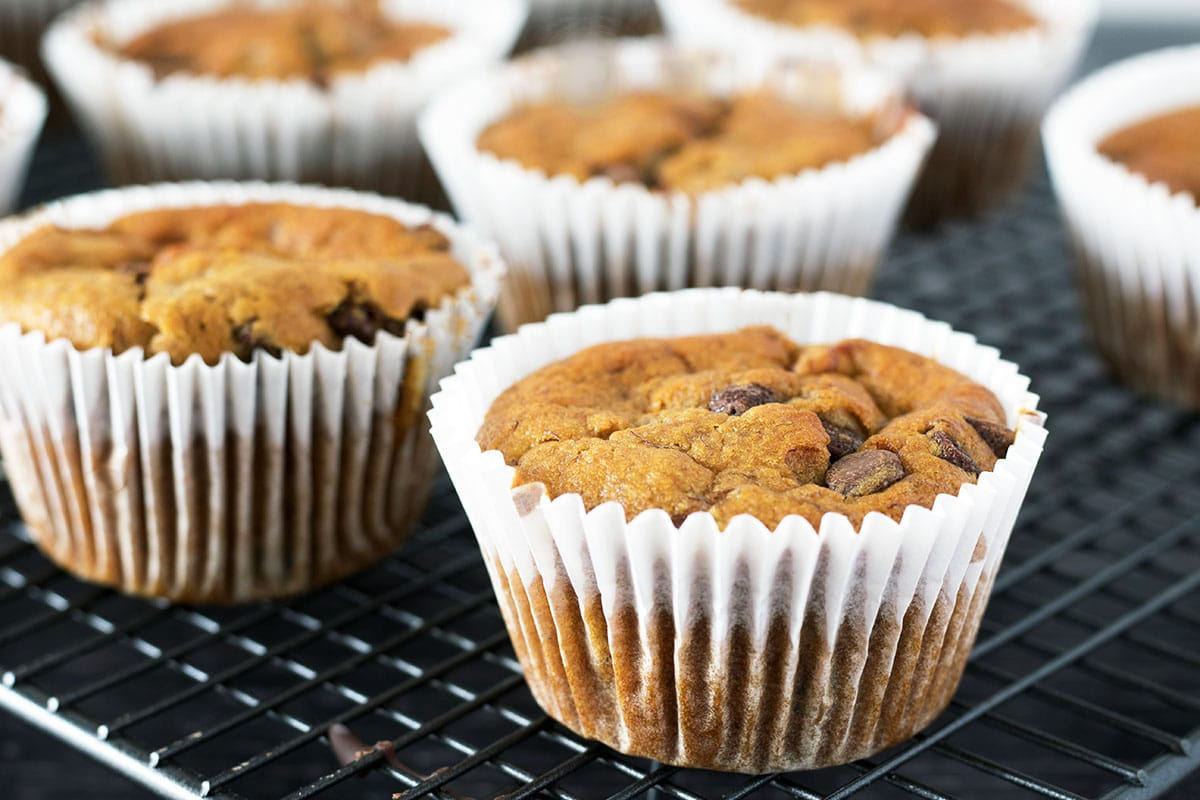 Vegan chocolate chip banana muffins on cooling rack