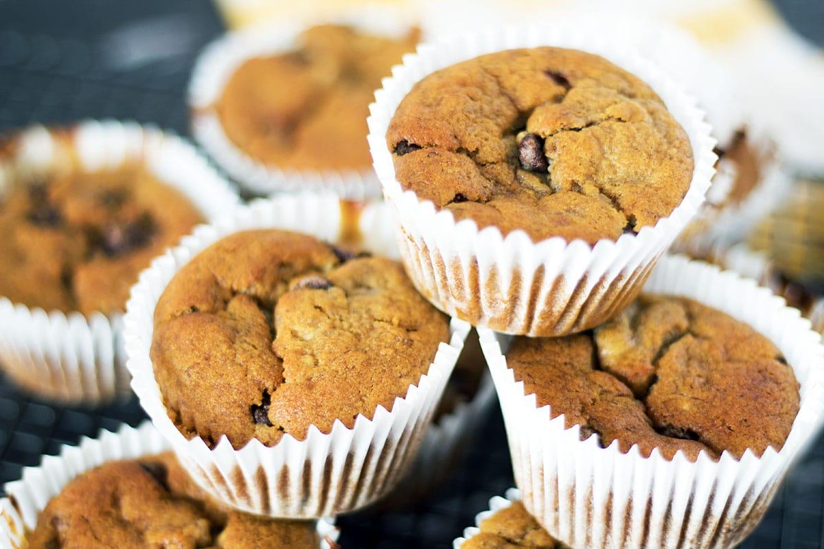 Vegan chocolate chip banana muffins on cooling rack overhead shot