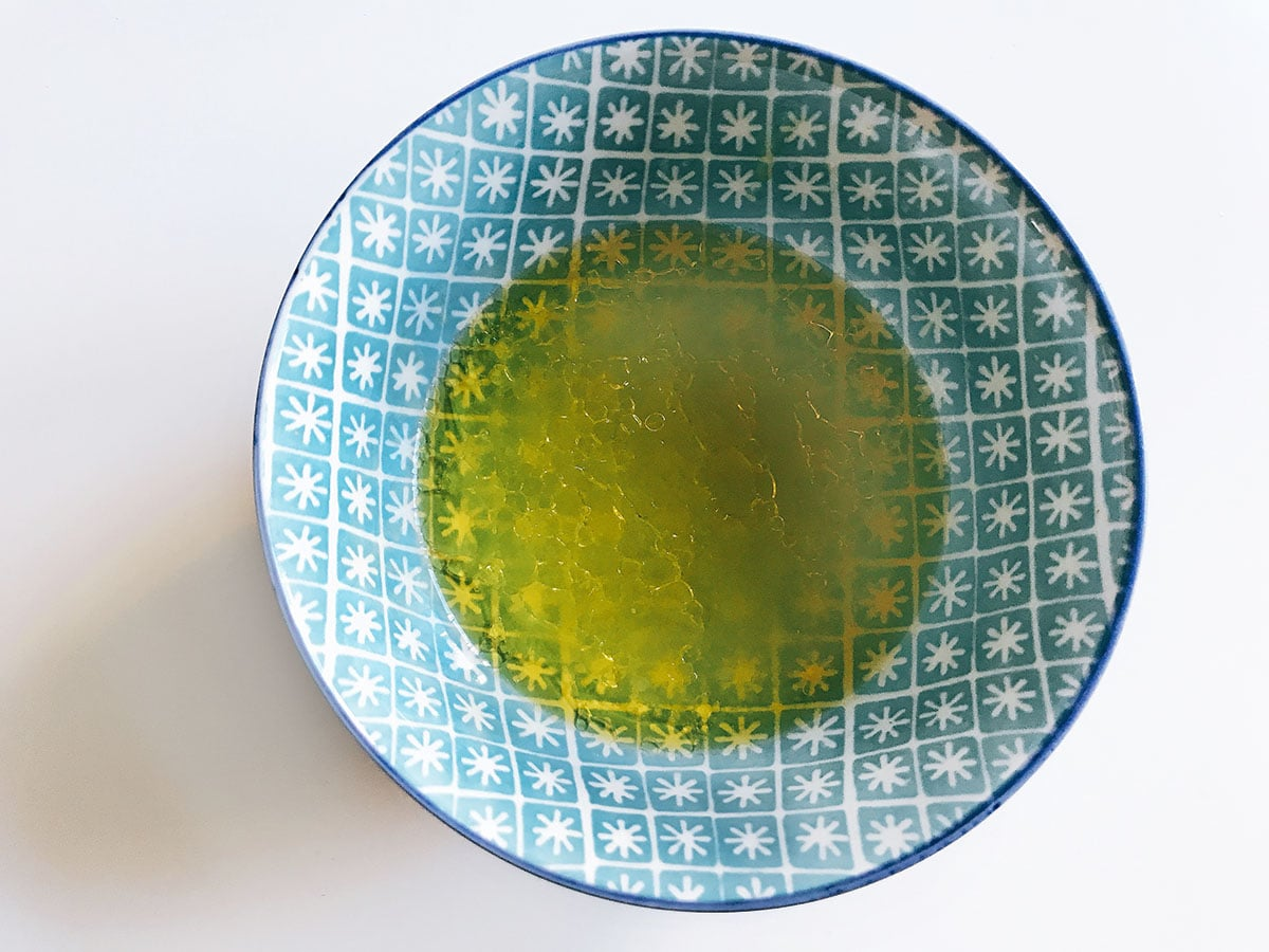 olive oil and lemon juice in small blue bowl
