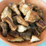 roasted jerusalem artichokes in terracotta bowl
