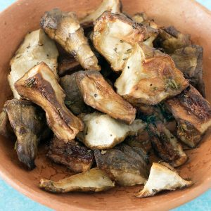 roasted jerusalem artichokes in terracotta bowl