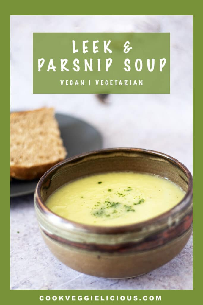 leek and parsnip soup in bowl with bread in background