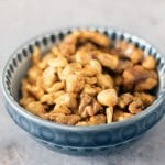 vegan spiced nuts in blue bowl by Cook Veggielicious