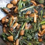 sauteed kale in wok with mushrooms and miso