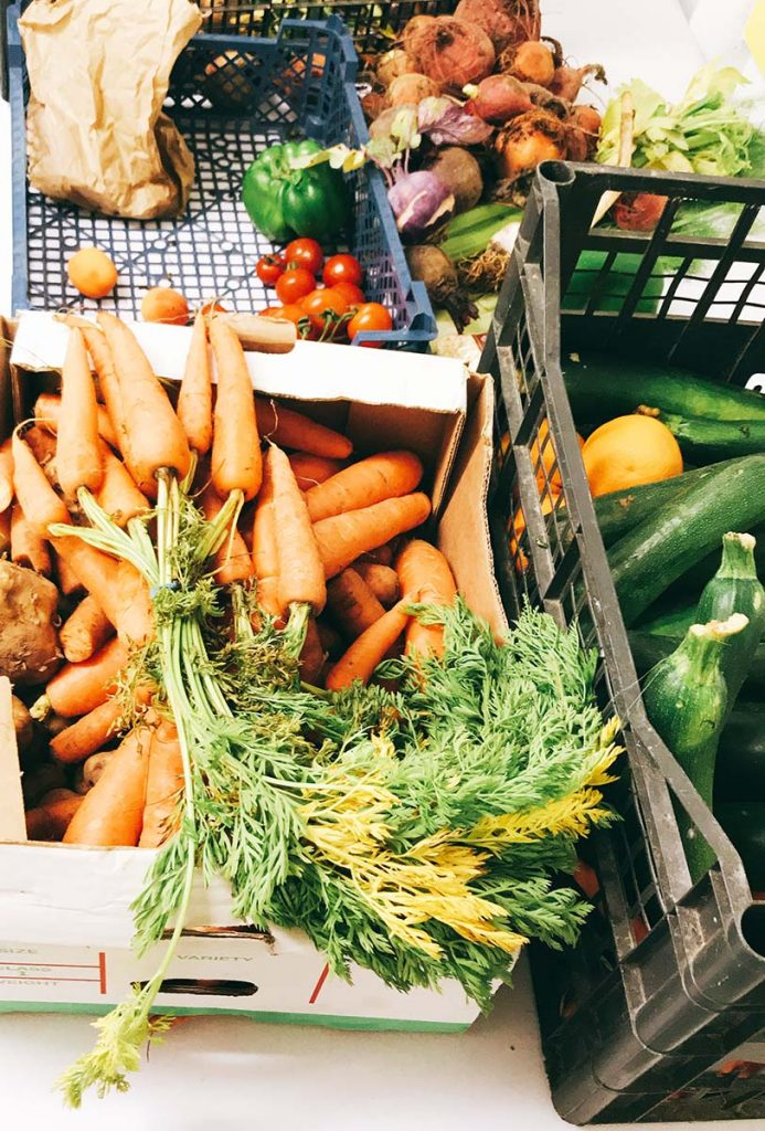 carrots, courgettes, tomatoes, peppers, beetroot and other seasonal vegetables in boxes