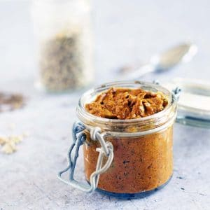 tikka paste in jar with spices in background