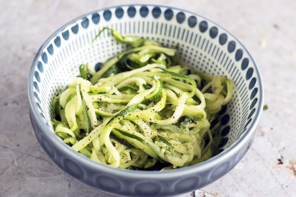 spiralised courgette in blue and white bowl