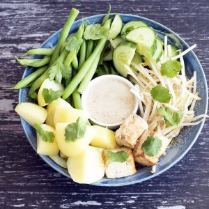 overhead shot of vegan gado gado bowl with potatoes, beans, coriander, cucumber, bean sprouts and tofu