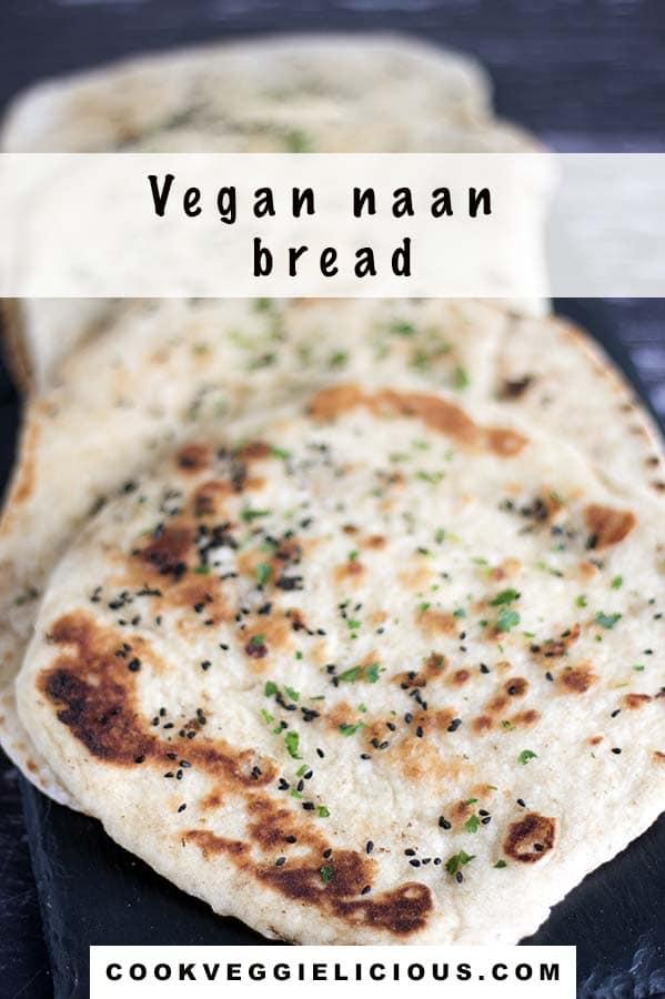 vegan naan bread on black slate platter