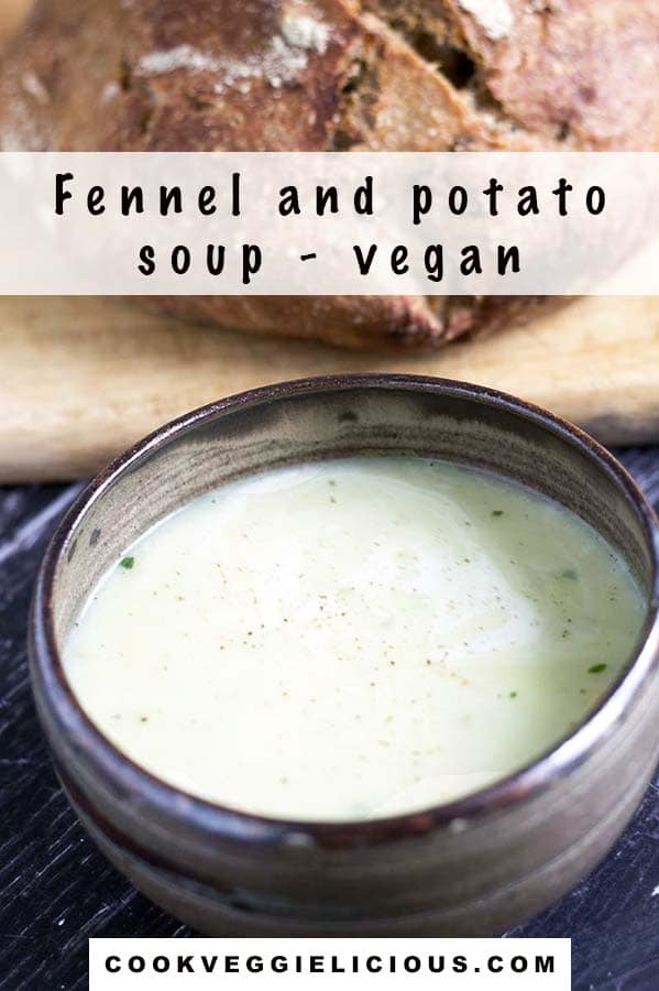 fennel and potato soup in bowl with loaf of brown bread on board in background