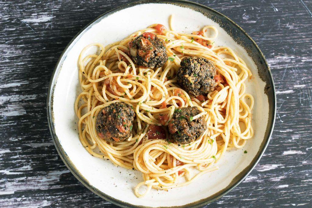 vegan mushroom meatballs and spaghetti on ceramic plate
