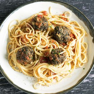 mushroom meatballs and spaghetti on ceramic plate